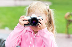 Little girl with the camera Stock Photo