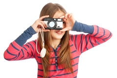 Little girl with a camera. On a white Royalty Free Stock Image