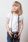 Little girl with camera Royalty Free Stock Photos