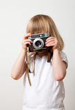 Little girl with camera Royalty Free Stock Images