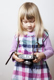 Little girl with camera Stock Photos