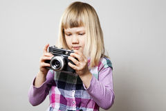 Little girl with camera Royalty Free Stock Image