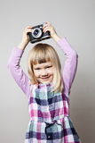Little girl with camera Stock Images