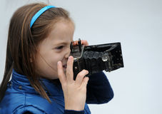 Little girl with camera Stock Photo