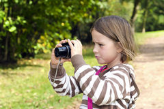 Little girl with the camera Stock Photography