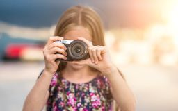 Little girl with camera Stock Photography