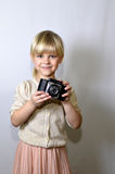 Little girl with a camera Royalty Free Stock Photography