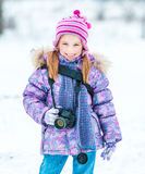 Little girl with a camera Royalty Free Stock Photos