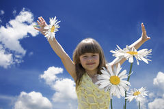 The little girl in camomiles Stock Photo