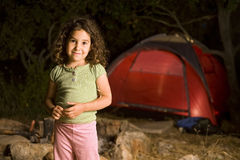Little girl at a camp. At night with a red tent Royalty Free Stock Images