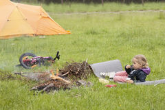 Little girl camping Royalty Free Stock Photography