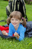 Little girl camping with sleeping bag Royalty Free Stock Photography