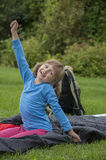 Little girl camping with sleeping bag Stock Photography