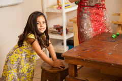 Little girl can't sit still Stock Photos