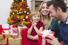 Little girl can't wait for her present Royalty Free Stock Photos