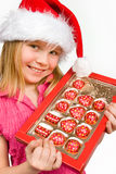 Little girl with candies in box Royalty Free Stock Image