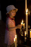 Little girl with the candle. In the church Royalty Free Stock Images