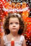 Little girl with candle. Little girl with candle and a christmas decorations Stock Photo