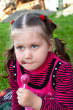 Little girl with candy Royalty Free Stock Photo