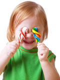 Little girl with candy Stock Photo
