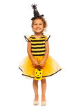 Little girl with candy bucket on Halloween. Full height portrait of a beautiful smiling little girl in bee Halloween costume with bucket for candies isolated on stock photography