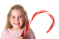 Little girl with candy cane Royalty Free Stock Photo