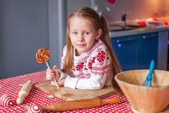 Little girl with candy in hand will prepare Stock Photo
