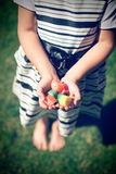 Little girl with candy in hands Royalty Free Stock Photos