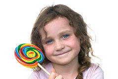 Little girl and candy pin wheel sucker Stock Photos