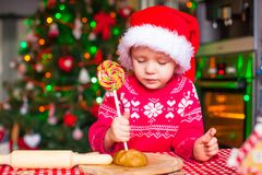 Little girl with candy preparing Christmas cakes Stock Photography