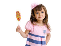 Little girl with candy in studio isolated Stock Images