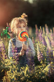 Little girl and candy royalty free stock photography