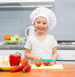 Little girl cutting tomatoes Royalty Free Stock Photography