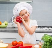 Little girl in with Pepper Royalty Free Stock Image