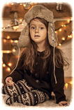 Little girl in a cap Stock Photo