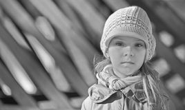 Little girl in cap and jacket Stock Images