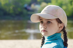 Little girl in a cap portrait Stock Image