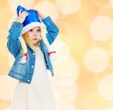 Little girl cap Santa Claus. Stock Photo