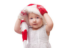 Little girl in a cap of Santa Claus. Isolated Stock Photo