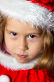 Little girl in a cap of Santa Claus. Royalty Free Stock Images