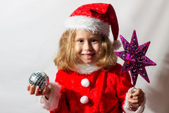 Little girl in a cap of Santa Claus. Royalty Free Stock Image