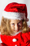 Little girl in a cap of Santa Claus. Stock Image