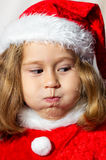 Little girl in a cap of Santa Claus. Stock Photo