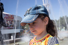 Little girl in cap. Stock Images