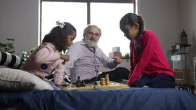 Little girl captured a pawn and celebrates at home stock video