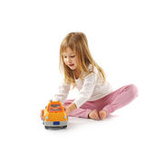 Little girl with car Stock Images
