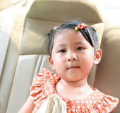 Little girl in the car Stock Photos