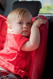 Little girl in car safety seat Stock Images
