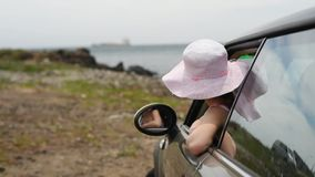 Little girl in car stock footage