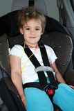 Little Girl in Car Seat Stock Images